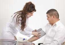 Measuring blood pressure stock photography