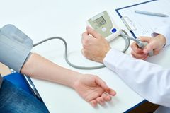 Measuring Blood Pressure. Above view closeup of unrecognizable doctor measuring blood pressure using tonometer in office, copy space royalty free stock images