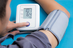 Measuring blood pressure. With digital equipment royalty free stock photography