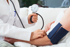 Measuring the blood pressure Stock Photography