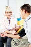 Measuring blood pressure at home Royalty Free Stock Photo