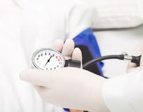 Measuring blood pressure in the hospital. Royalty Free Stock Photography