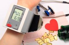 Measuring blood pressure, medicine concept Stock Photo