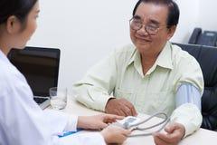 Measuring blood pressure Stock Image