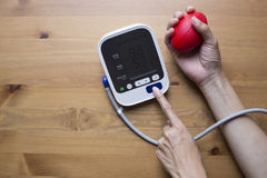 Measuring blood pressure and pulse while nervous Stock Photo
