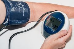Measuring blood-pressure Stock Photo