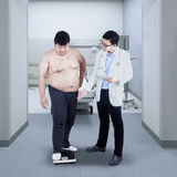 Measuring body weight Royalty Free Stock Photo