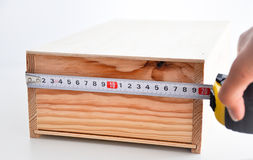 Measuring a box with roulette Stock Photography