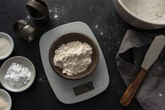 Measuring brown rice flour on a digital scale stock photography