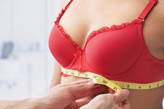 Measuring bust base size. Of woman wearing red bra Royalty Free Stock Photography