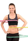 Measuring bust, waist, hips. Beautiful fit girl wrapped with three measuring tapes in inch. Stock Photography