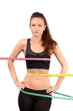 Measuring bust, waist, hips. Beautiful fit girl wrapped with three measuring tapes in inch. Stock Image
