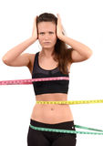 Measuring bust, waist, hips. Beautiful fit girl wrapped with three measuring tapes in inch. Royalty Free Stock Image