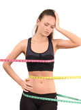 Measuring bust, waist, hips. Beautiful fit girl wrapped with three measuring tapes in inch. Stock Images
