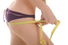 Measuring buttocks. Stock Image
