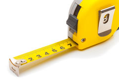 Measuring and calculating instruments - yellow ruler on white Royalty Free Stock Image