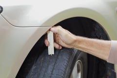 Measuring car tyre profile Royalty Free Stock Photos