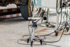Measuring the composition and substances in the exhaust fumes in. A garage Stock Photos