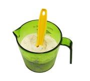 Measuring cup with flour Stock Photos