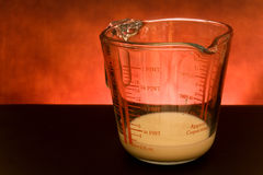 Measuring Cup With Milk Royalty Free Stock Photography