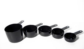 Measuring Cups. Set of black measuring cups used for cooking or baking royalty free stock images
