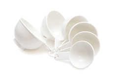 Measuring cups on white Stock Images