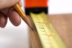 Measuring for the cut (shallow DOF) Stock Photography