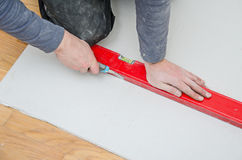 Measuring and cutting gypsum plasterboard Royalty Free Stock Photography