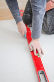Measuring and cutting gypsum plasterboard Stock Photo