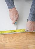 Measuring and cutting gypsum plasterboard Royalty Free Stock Images