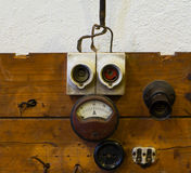 Measuring device socket and fuse on wooden panel Stock Photo