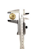 Measuring the diameter of the copper coin metal calliper Royalty Free Stock Images
