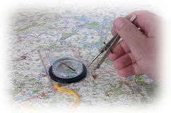 Measuring of the distance. On a map Stock Images