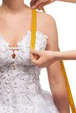 Measuring the distance from shoulder to breast Royalty Free Stock Image