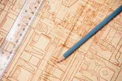 Measuring, drawing instruments and old drawings. Measuring and drawing instruments and old drawings are on the table Stock Photo