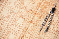 Measuring, drawing instruments and old drawings. Measuring and drawing instruments and old drawings are on the table Royalty Free Stock Photos