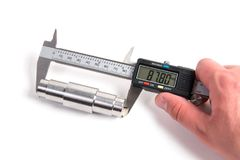 Measuring with electronic digital caliper. Precise measurement of metal part. Measuring with electronic digital caliper stock images
