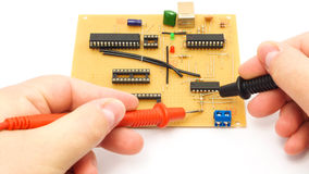 Measuring An Electronics Board. Measuring A Circuit Board Using Multimeter Probes royalty free stock images