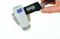 Measuring euro banknotes with caliper Stock Photo