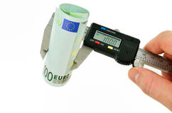 Measuring euro banknotes with caliper Royalty Free Stock Photography