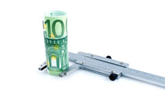 Measuring euro banknotes with  calipers Stock Images