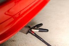 Measuring exhausts of a car in garage Stock Photos