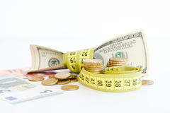 Measuring the financial success. Dollar bills tied up with measuring tape suggesting measuring the financial success Stock Images