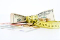 Measuring the financial success. Dollar bills tied up with measuring tape suggesting measuring the financial success Stock Photo