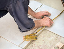 Measuring a floor tile Royalty Free Stock Photo