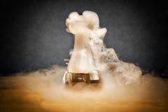 Measuring glass smoke Royalty Free Stock Photo