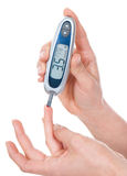 Measuring glucose blood test glucometer Stock Photos