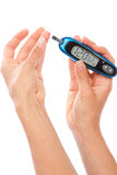 Measuring glucose level blood test royalty free stock photography