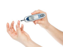 Measuring glucose level blood test. Diabetes patient measuring glucose level blood test using ultra mini glucometer and small drop of blood from finger and test Stock Photography