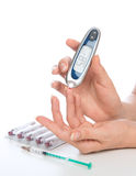 Measuring glucose level blood test with glucometer Royalty Free Stock Images